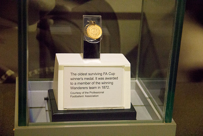 The oldest surviving FA Cup winner's medal at Tickets and flags on display at National Football Museum