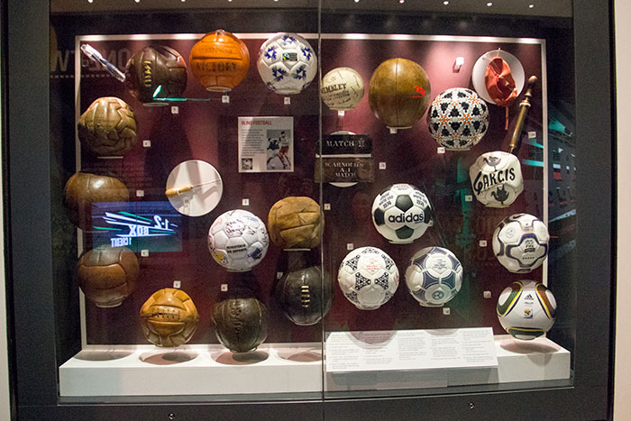 Football balls on display, from different periods at National Football Museum