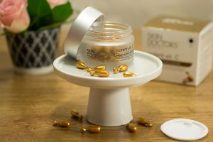 Skin Doctors Vit C. Ampoules scattered around.