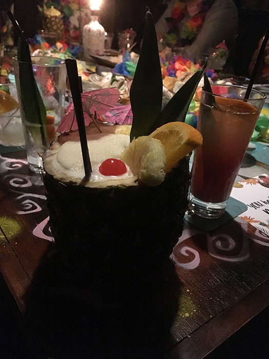 A cocktail in a pineapple