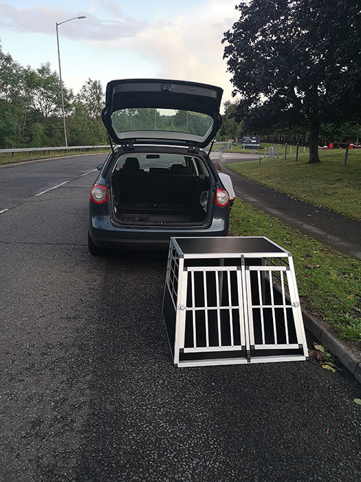 Dog cage for the car