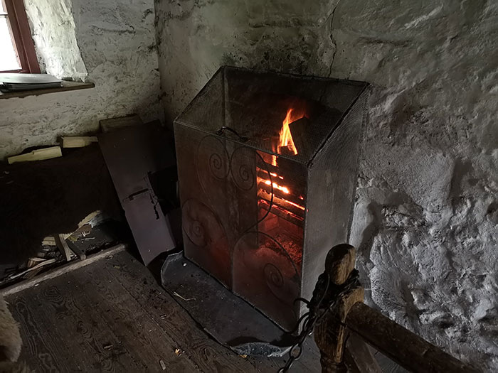 Fire burning in a building at St Fagans Museum
