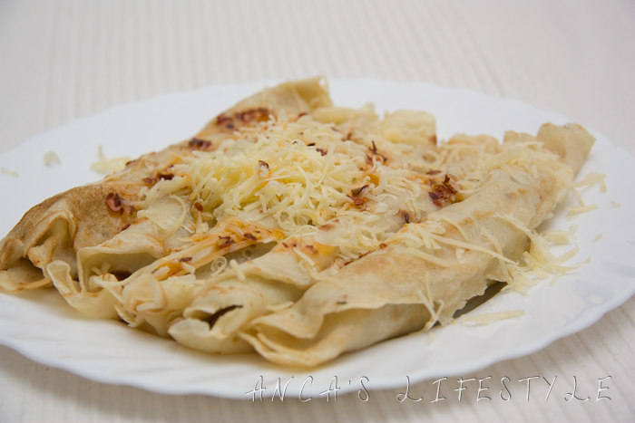 Crepes with mushrooms and spicy oil