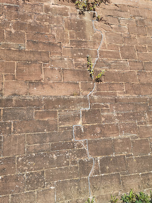 High Park Reservoir's wall cracked in German bombing. Outside